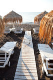 Sunbeds in Perissa, Santorini, Greece Royalty Free Stock Photography