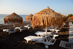 Sunbeds in Perissa, Santorini, Greece Royalty Free Stock Image