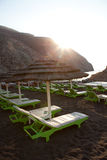 Sunbeds in Perissa, Santorini, Greece Stock Photography