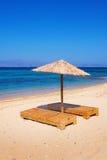 Sunbeds on Plaka beach, Naxos island Royalty Free Stock Photos