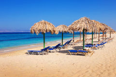 Sunbeds on Plaka beach, Naxos island Royalty Free Stock Photography