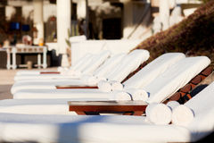 Sunbeds by the pool Royalty Free Stock Photography