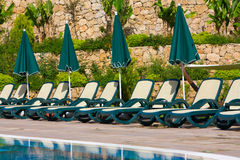 Sunbeds by the pool Royalty Free Stock Images