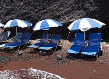 Sunbeds at the Red Beach. Akrotiri. Santorini. Royalty Free Stock Photo