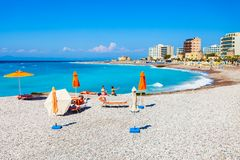 Sunbeds at Rhodes beach, Greece. Sunbeds with umbrellas at the Rhodes city beach in Rhodes island in Greece stock images