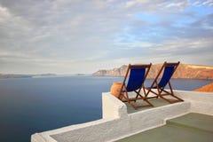 Sunbeds on Santorini Stock Photo