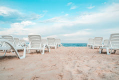 The sunbeds on the sea beach. Royalty Free Stock Images