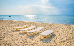 Sunbeds on a sea shore Royalty Free Stock Image