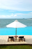 Sunbeds at the sea view swimming pool Royalty Free Stock Photography