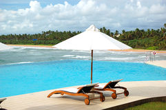 Sunbeds at the sea view swimming pool Royalty Free Stock Image