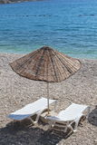 Sunbeds and sun parasol Royalty Free Stock Images