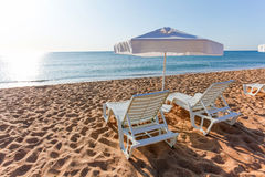 Sunbeds and sun umbrellas on the beach Royalty Free Stock Images