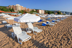 Sunbeds and sun umbrellas on the beach Stock Photo