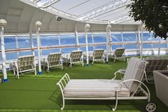 Sunbeds on sundeck of the cruise ship Royalty Free Stock Photo