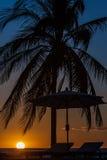 Sunbeds at sunset Stock Photos