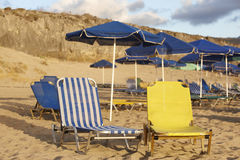 Sunbeds and sunshades in a mediterranean beach. Crete Royalty Free Stock Image