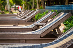Sunbeds beside swimming pool Royalty Free Stock Photo
