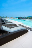 Sunbeds at swimming pool of luxury hotel Stock Photos