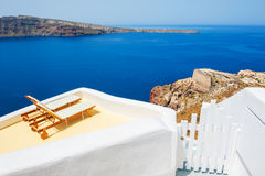 Sunbeds on the terrace of a hotel. Santorini island, Greece. Stock Images