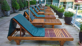 Sunbeds in tropical resort hotel. Resort pool with sunbeds near the tropical beach Stock Photo