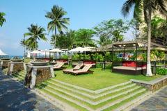 Sunbeds in tropical resort hotel Stock Image