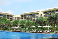 Sunbeds in tropical resort hotel Stock Photos