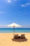 Sunbeds and umbrella on the beach Stock Photography