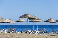 Sunbeds and umbrella on the beach, close up. Turkey Royalty Free Stock Images