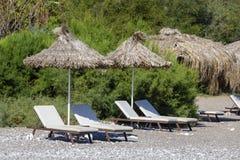 Sunbeds and umbrella on the beach, close up. Turkey Royalty Free Stock Photos