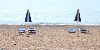 Sunbeds and umbrellas. Sunbeds and umbrella on the beach royalty free stock images