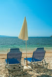 Sunbeds and umbrella on the beach stock image