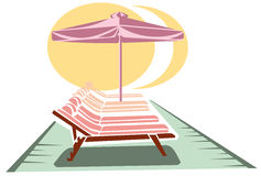 Sunbeds and umbrella Stock Image