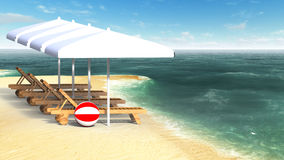 Sunbeds and umbrellas on beach Stock Photo