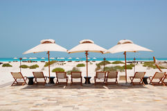 Sunbeds and umbrellas at the beach Royalty Free Stock Image