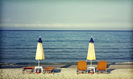 Sunbeds and umbrellas on the beach Stock Image