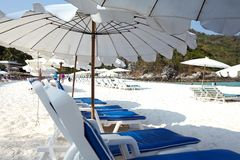 Sunbeds and umbrellas. On the beach royalty free stock photo