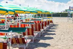 Sunbeds and umbrellas on the beach in Bellaria Igea Marina, Rimini, Italy Royalty Free Stock Images