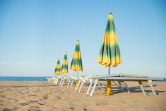 Sunbeds and umbrellas on the beach Royalty Free Stock Images