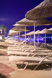 Sunbeds and umbrellas on the beach in the evening Stock Image