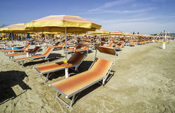 Sunbeds and umbrellas on the beach Royalty Free Stock Photography