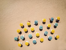 Sunbeds and umbrellas on hot sand. Relax on the beach - sunbeds and umbrellas on hot sand Royalty Free Stock Photography