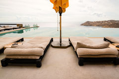 Sunbeds and umbrellas next to a pool Stock Photo