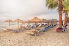 Sunbeds, umbrellas and palms on the Alikanas beach, Zakynthos Island, Greece. Stock Photo