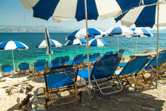 Sunbeds and umbrellas (parasols) on the beach in Corfu Island, Greece Royalty Free Stock Photography