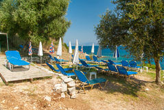 Sunbeds and umbrellas (parasols) on the beach in Corfu Island, Greece Stock Photography