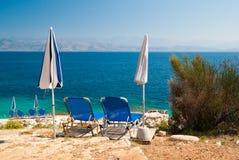 Sunbeds and umbrellas (parasols) on the beach, Corfu Island, Greece Stock Photo