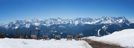 Sunbeds at wank mountain with lookout to zugspitze area Royalty Free Stock Photos