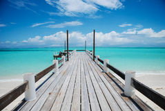 Sunbleached pier in Turks and Caicos. The sunbleached pier leads to the blue ocean on North Turks island, in the Turks and Caicos Stock Photos