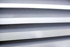 The sunblinds close. The sunblinds of grey colour close up Royalty Free Stock Photo