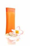Sunblock con il fiore e le coperture Fotografia Stock